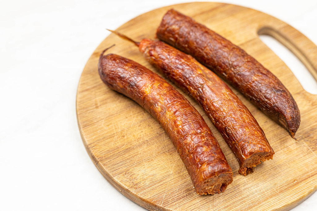 Raw Homemade Pork Meat Sausages on the wooden board