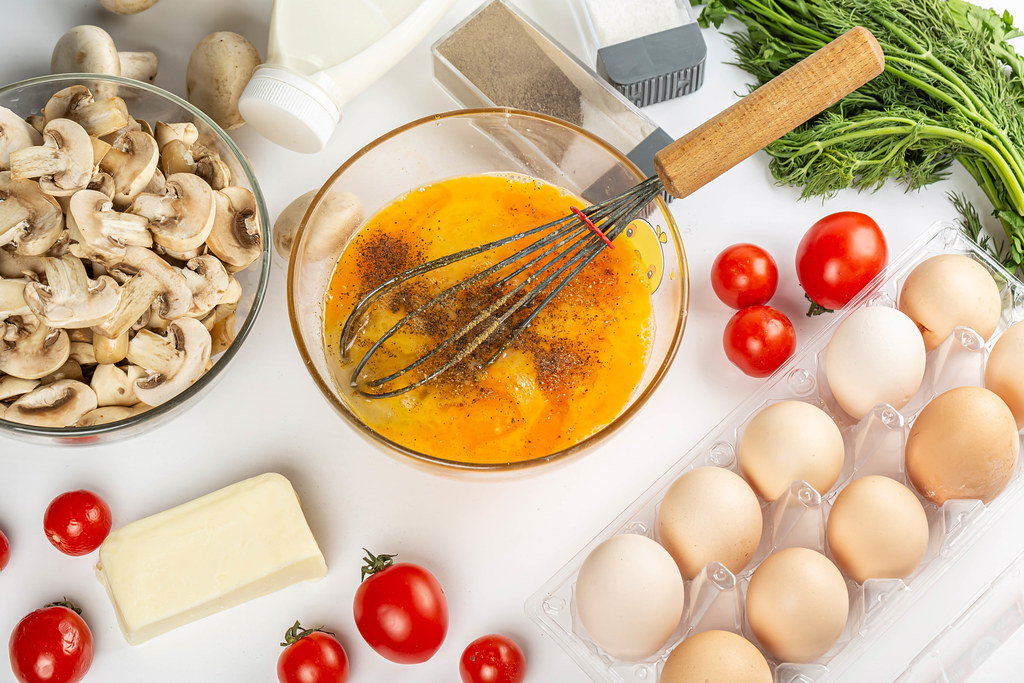 Raw ingredients for making an egg omelet