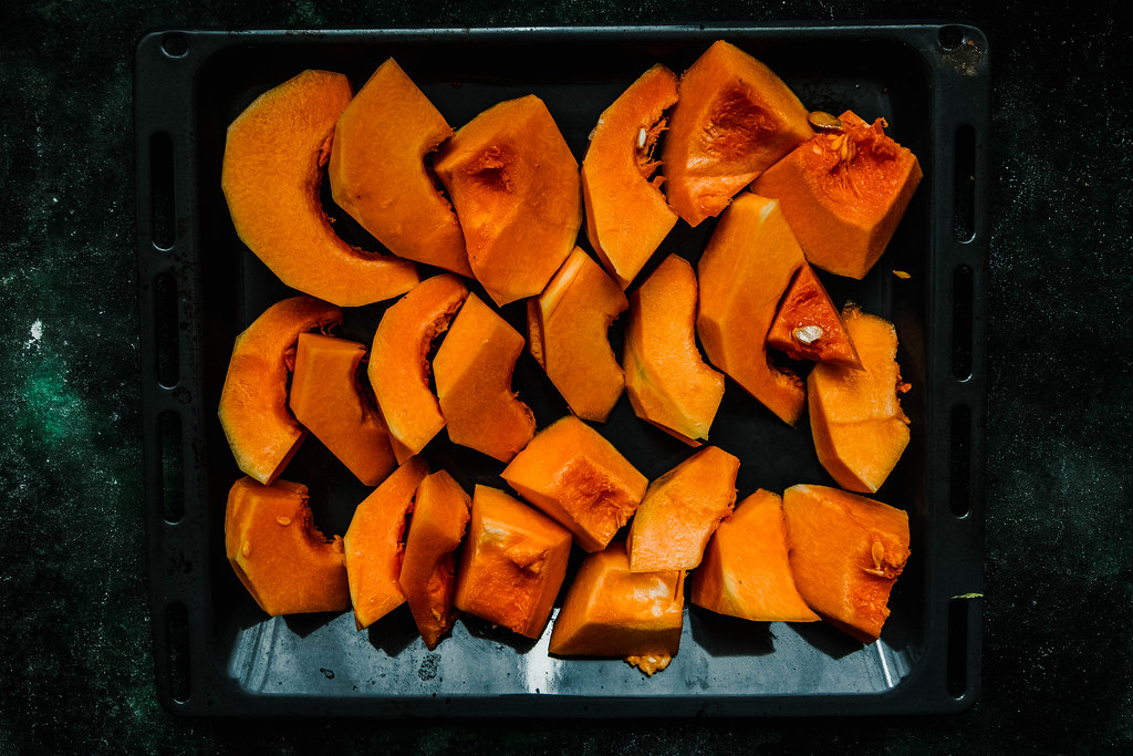 Raw Pumkin Slices On The Black Pan