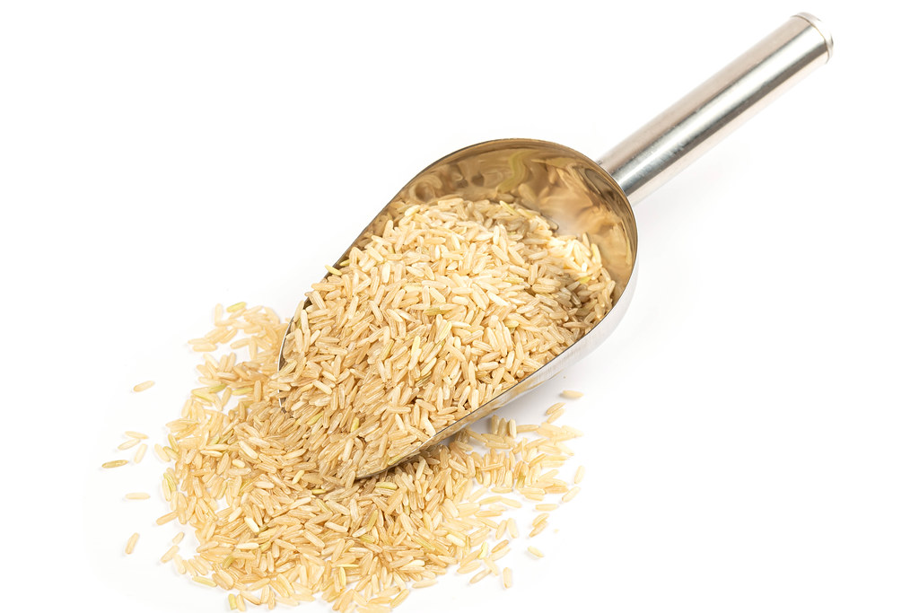Raw unpolished rice with a scoop