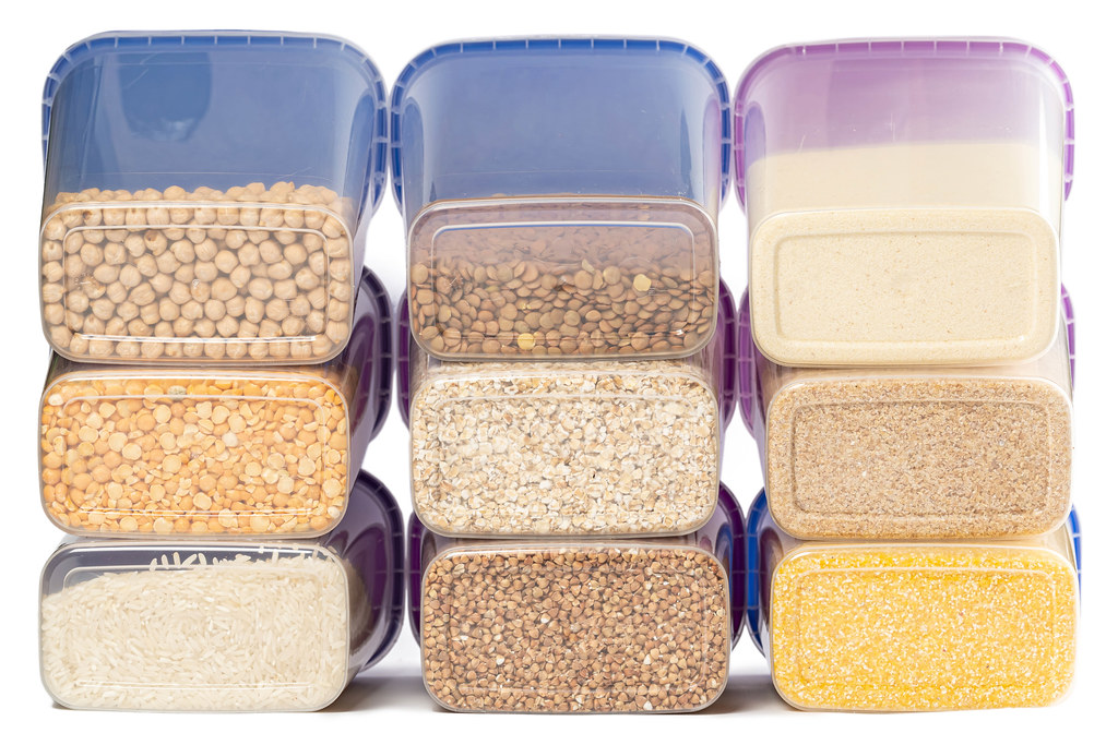 Raw various cereals in plastic containers