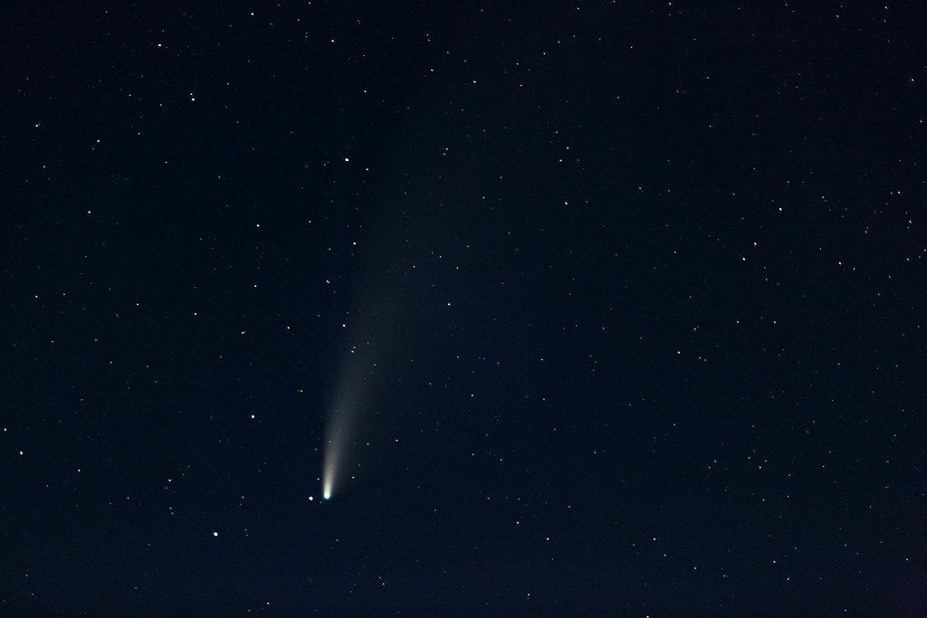 Real photo comet Neowise in the night sky with stars