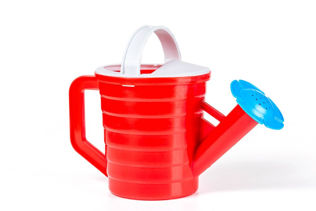 Red children's water dispenser on a white background