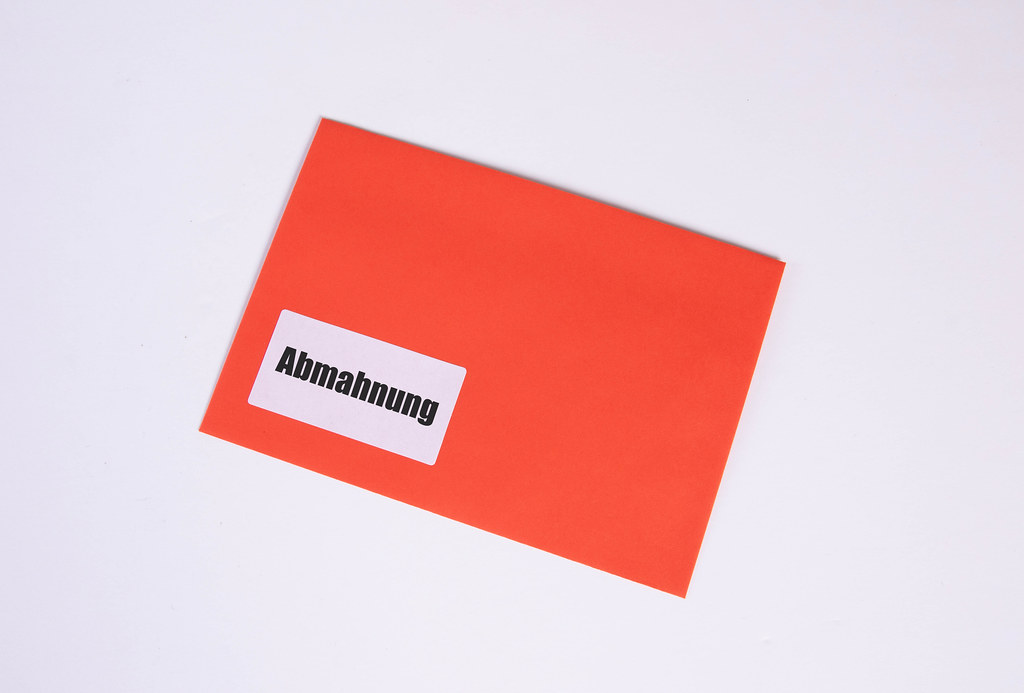 Red envelope with Abmahnung text on white background