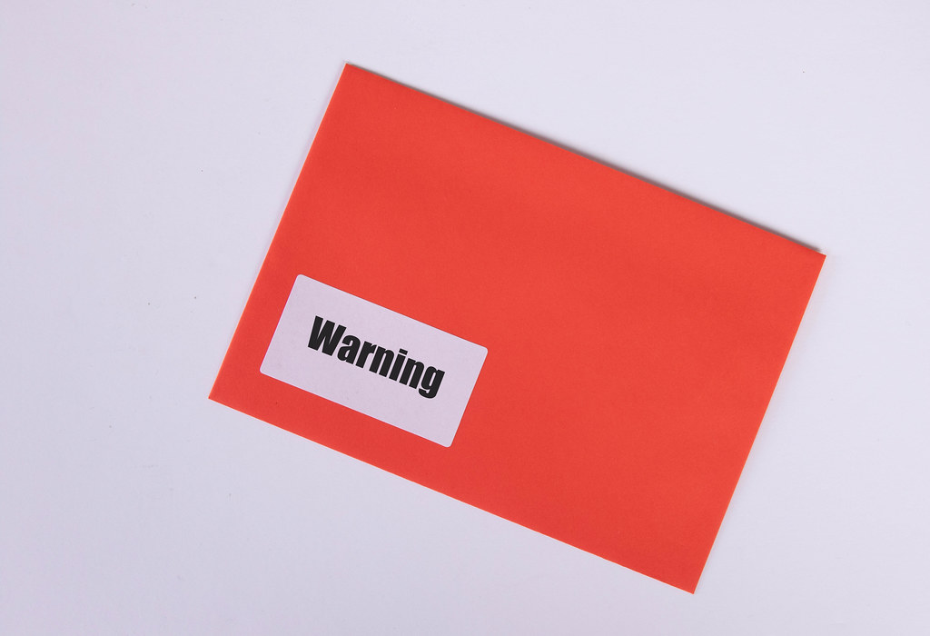 Red envelope with Warning text on white background