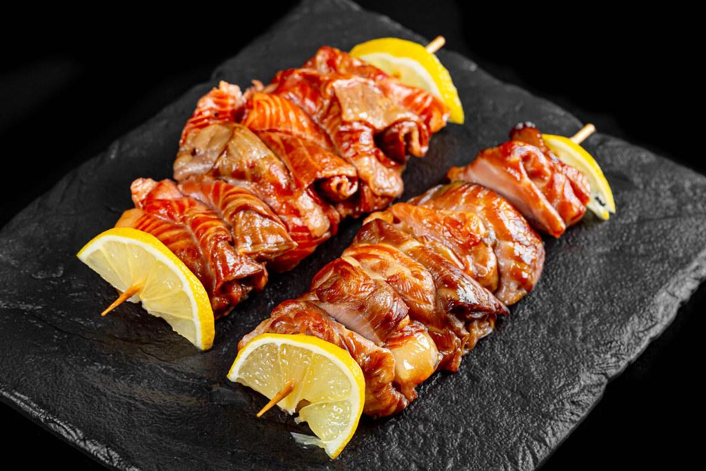 Red fish fried kebab with lemon