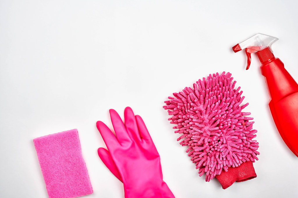Red house cleaning products on white background