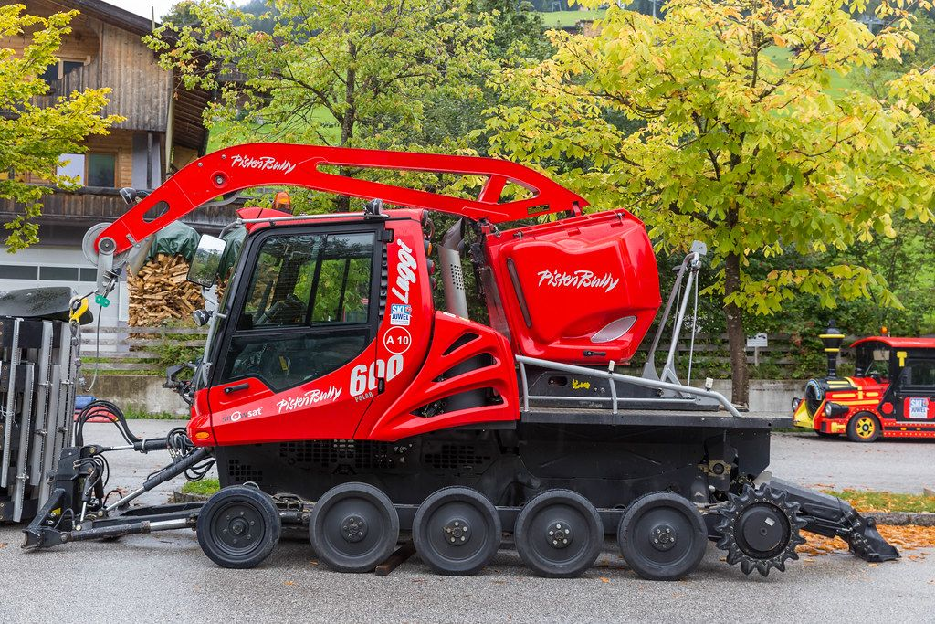 Red snow groomer in Alpbach: PistenBully 600 for preparing ski slopes