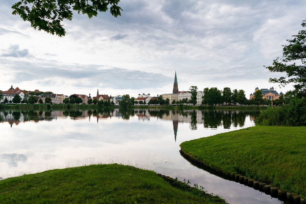 Reflection of Schwerin town and beautiful church in the lake