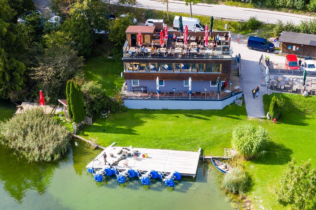 Restaurant-Café Fischerstube at Lake Reintal in Austria. Aerial view with wooden platform for anglers
