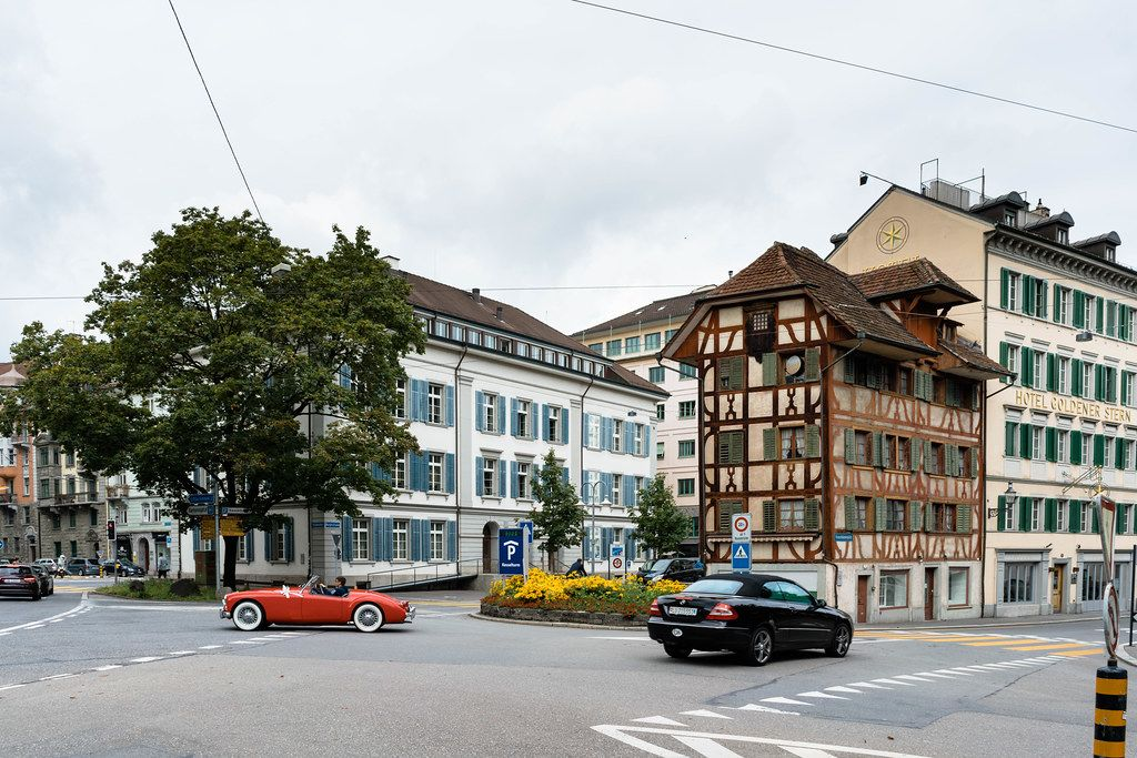 Retro car looking harmoniously in historic center of Lucerne, Switzerland