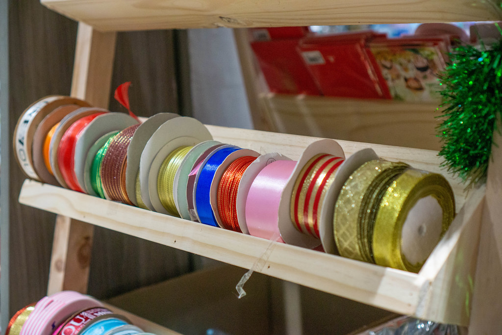 Ribbons in different Colors and Sizes for Gift Wrapping in a Craft Supply Section in a Bookstore