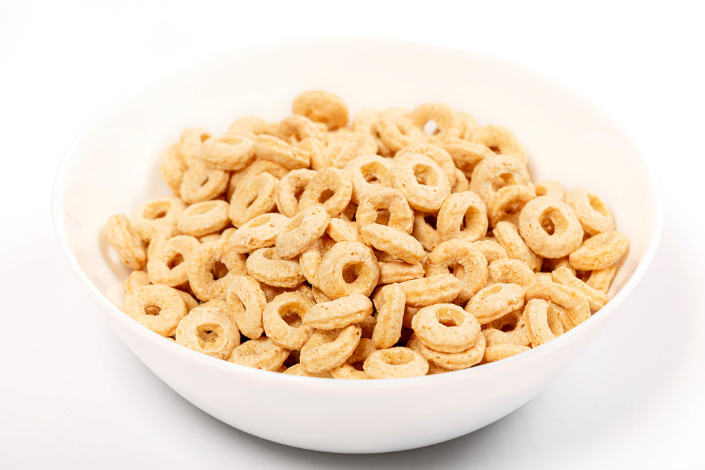 Rings from oat, corn and wheat in a white bowl