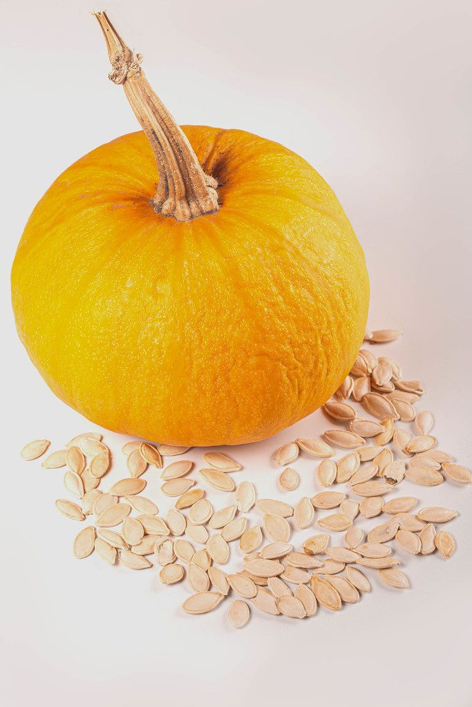 Ripe orange pumpkin with pumpkin seeds
