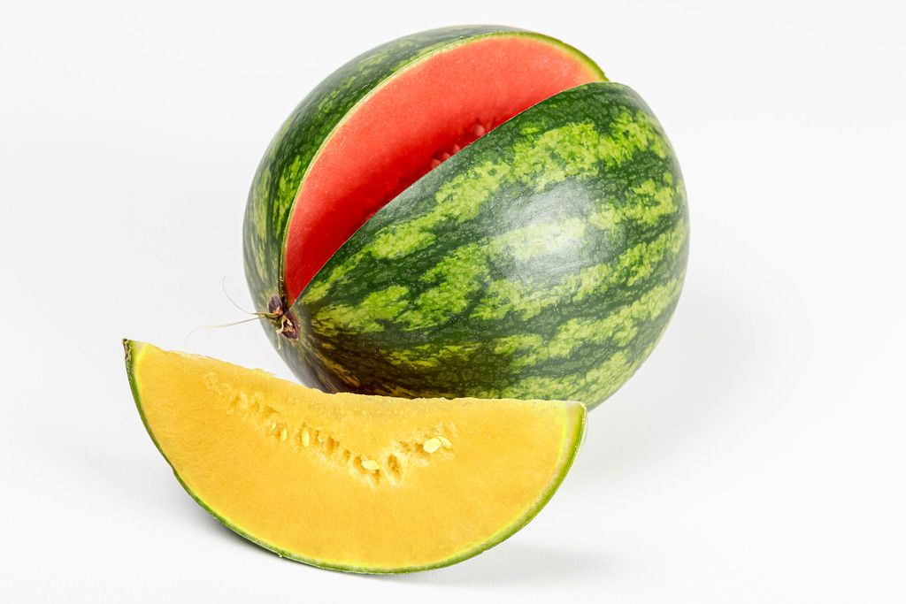 Ripe red watermelon with a piece of yellow watermelon