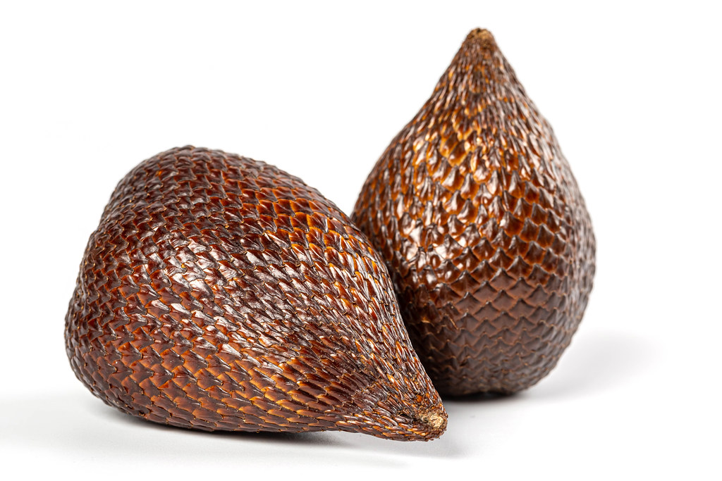 Ripe whole snake fruit on white