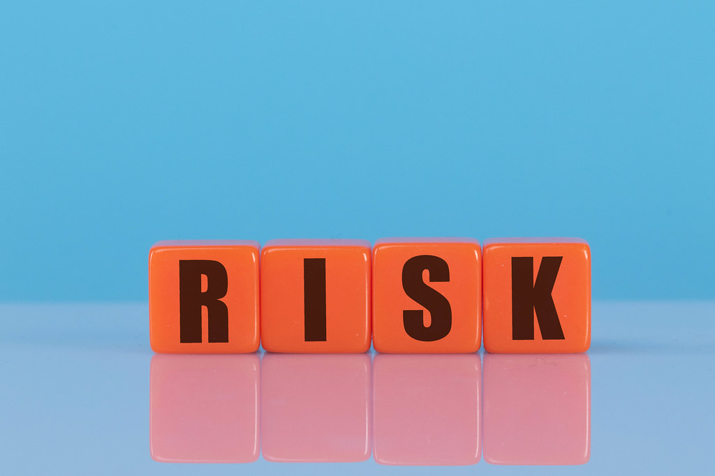 Risk text on orange cubes