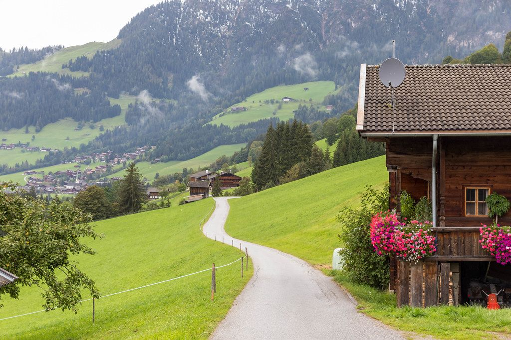 Road going through the Alpbach valley to the surrounding mountains in Tyrol, Austria