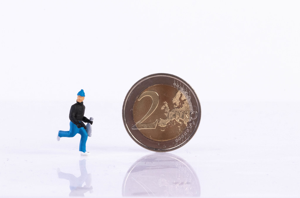 Robber and 2 Euro coin on white background
