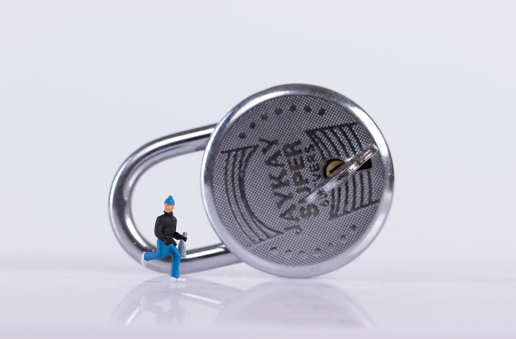 Robber and padlock on white background
