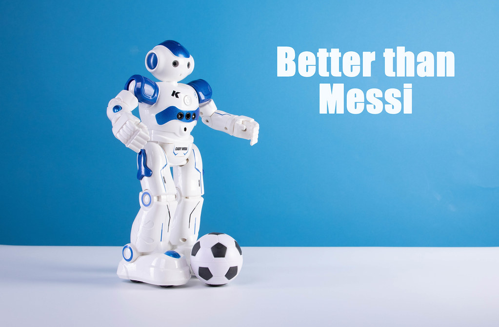 Robot and soccer ball with Better than Messin text on blue background