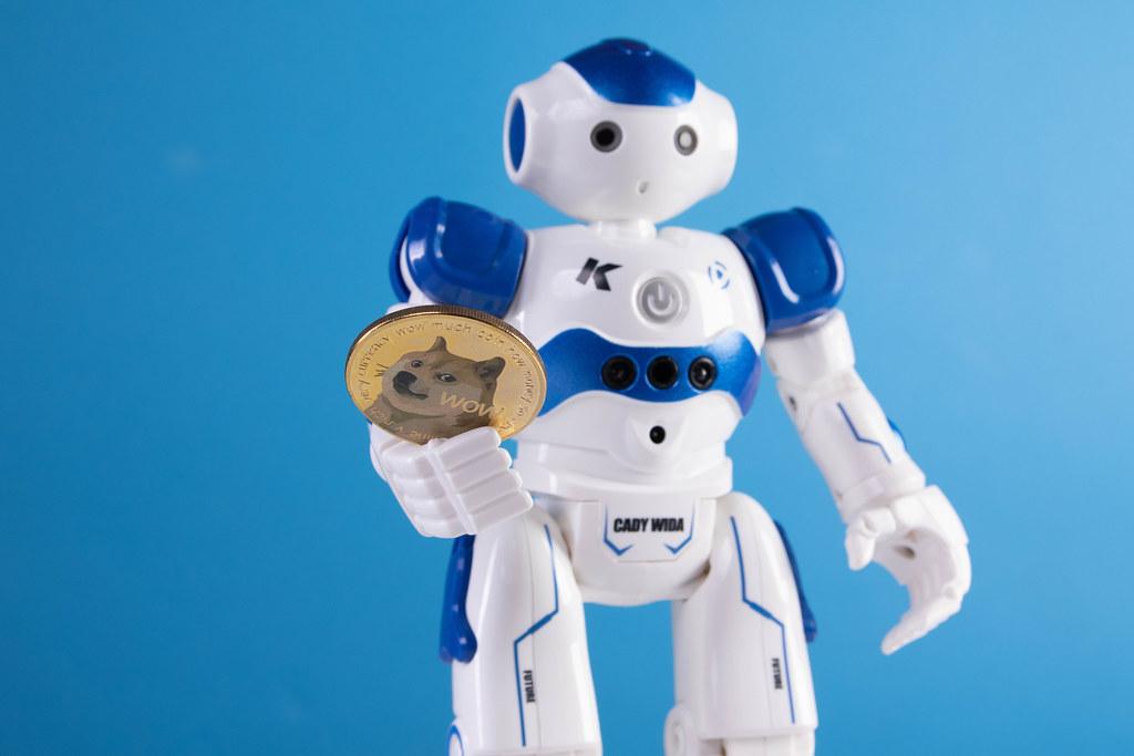Robot holding golden Dogecoin coin