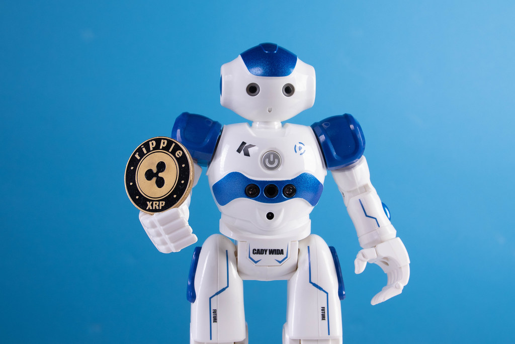 Robot holding Ripple coin