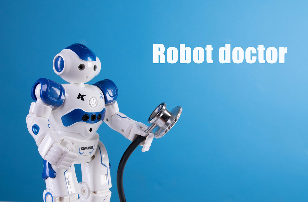 Robot holding stethoscope and Robot doctor text on blue background