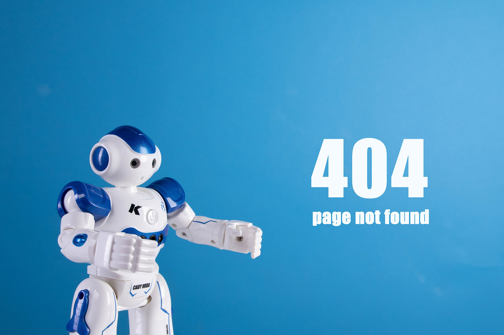 Robot with 404 page not found text on a blue background
