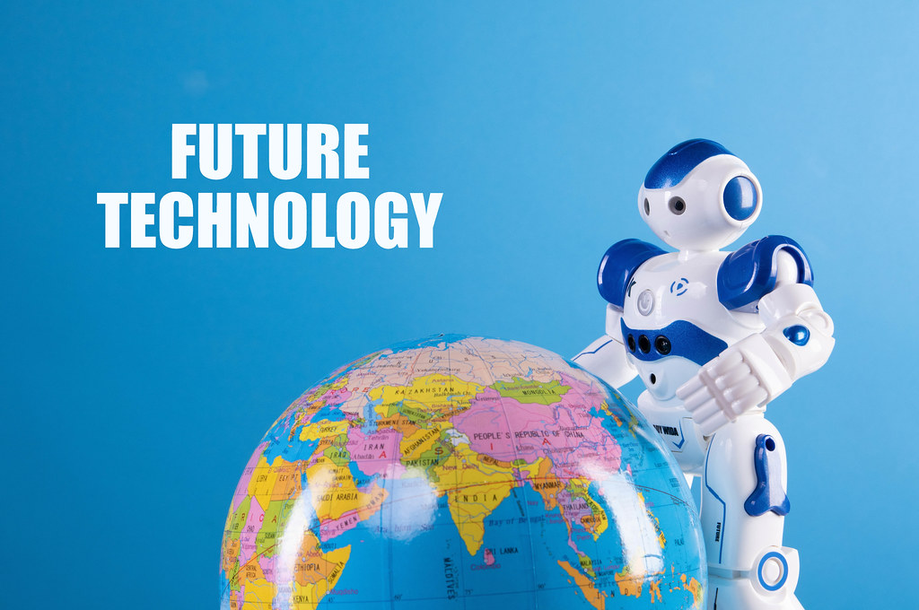 Robot with globe and Future technology text on blue background