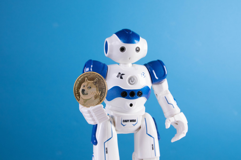 Robot with golden Dogecoin coin