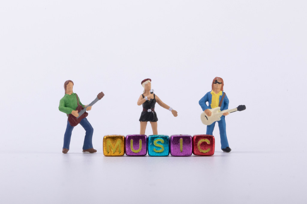 Rock band with Music text on white background