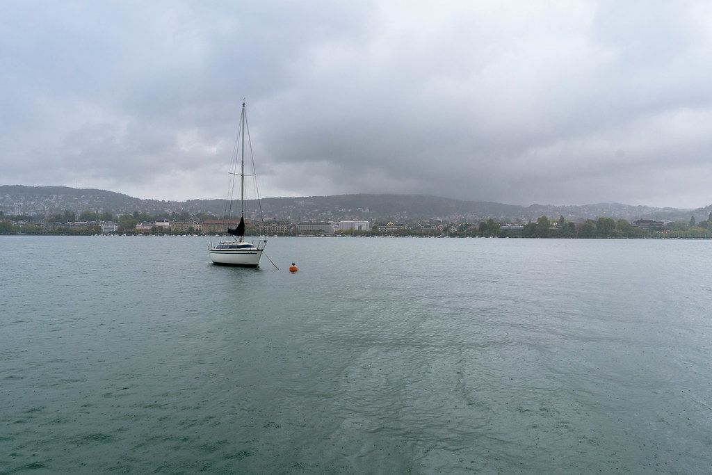 Sail boat moored in front of the city of Zurich