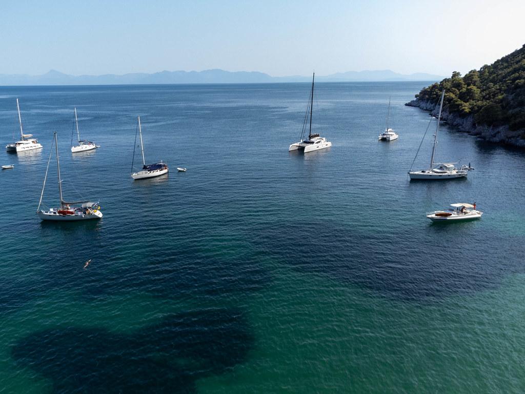 Sailing boats in the bay of Agnontas, Skopelos, Northern Sporades, Greece