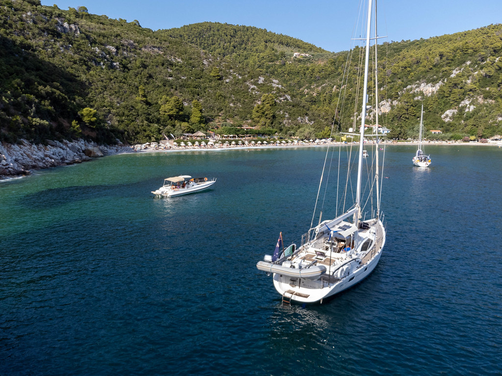 Sailing holiday in Greece: the beach and bay of Limnonari seen from the sea