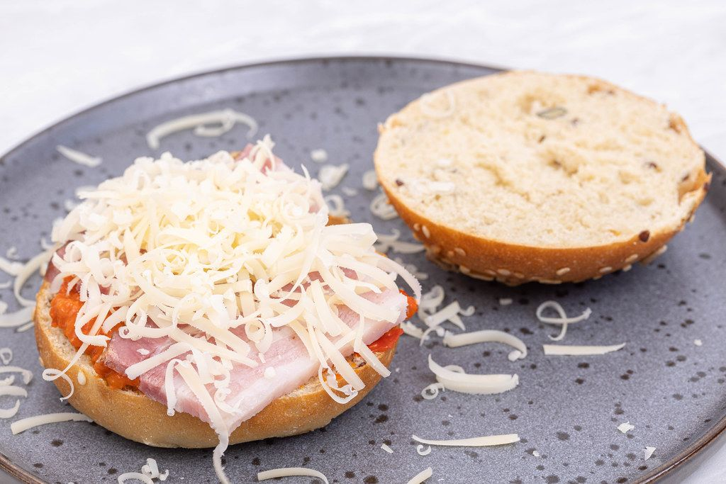 Sandwich with Buns Bacon Paprika spread and grated Cheese