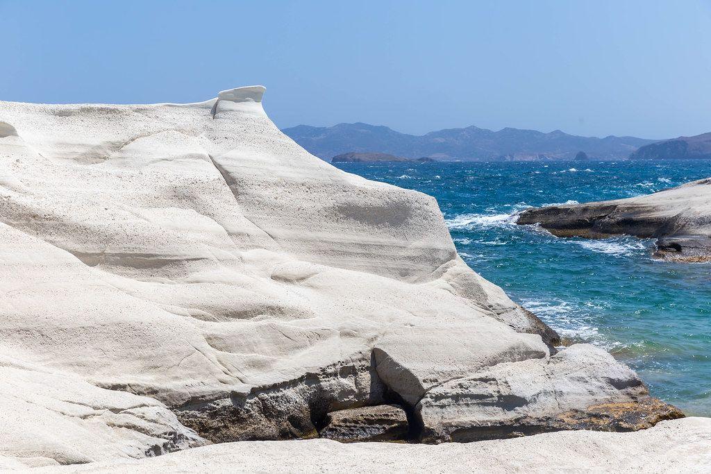 Sarakiniko on the bright, rocky coast of Milos, southwesternmost island in the Cyclades