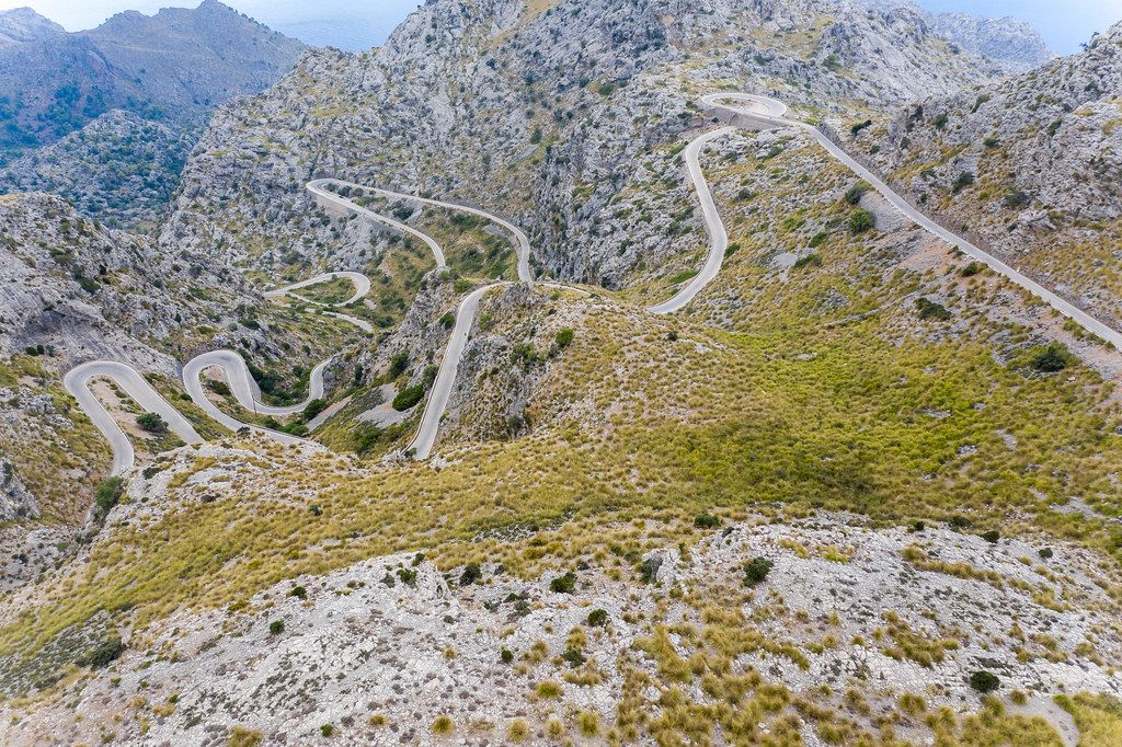 Scary road with many hairpin turns across the Serra de Tramuntana. Carretera de Sa Calobra, drone shot