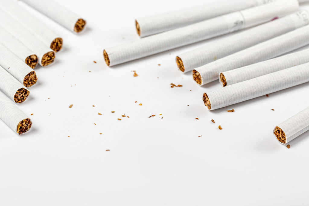 Scattered cigarettes on a white background, concept of harm to health