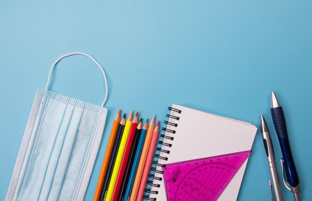 School supplies on blue background