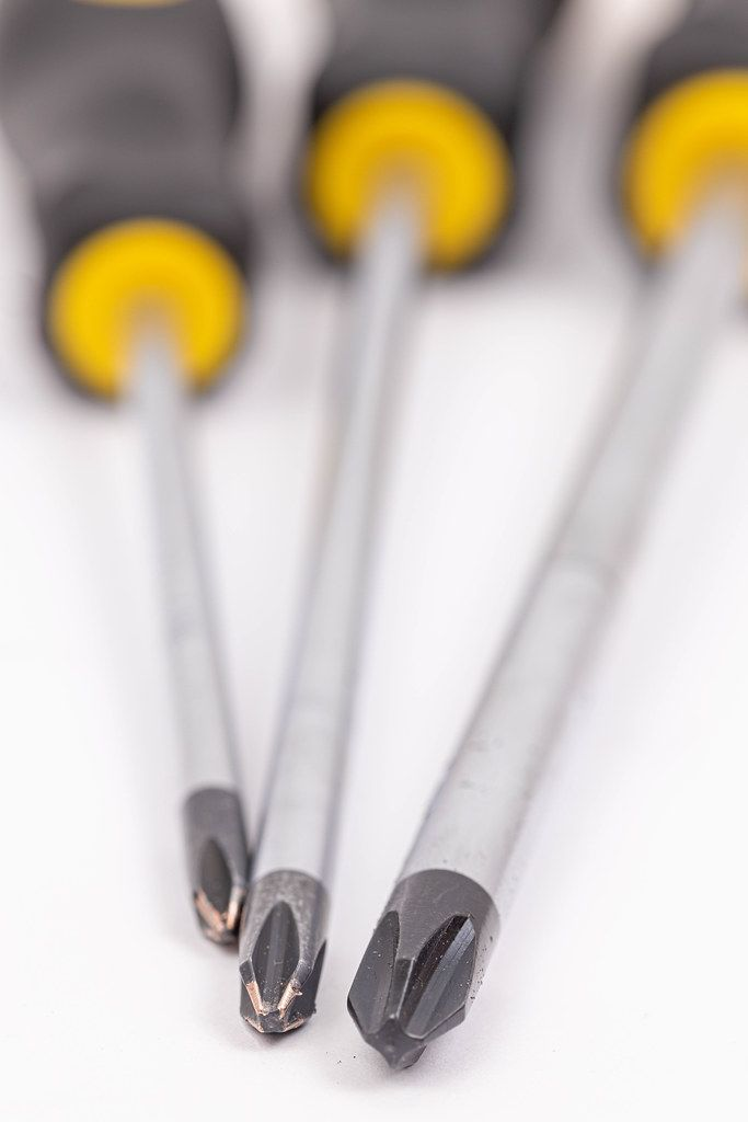 Screwdrivers above white background with shallow focus