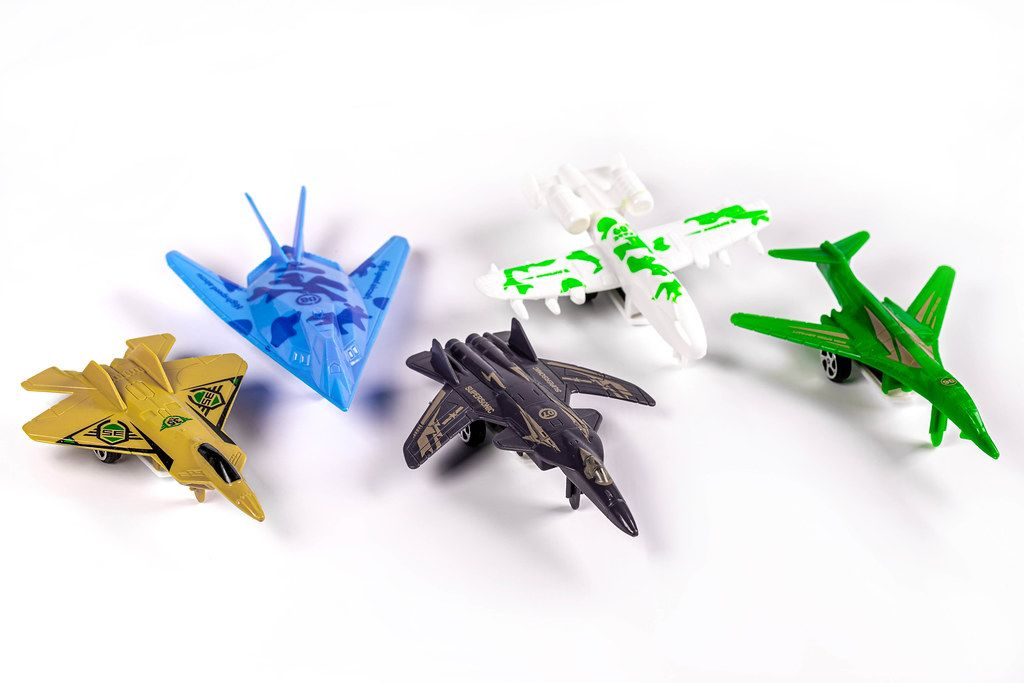 Set multi colored aircraft toys on white background