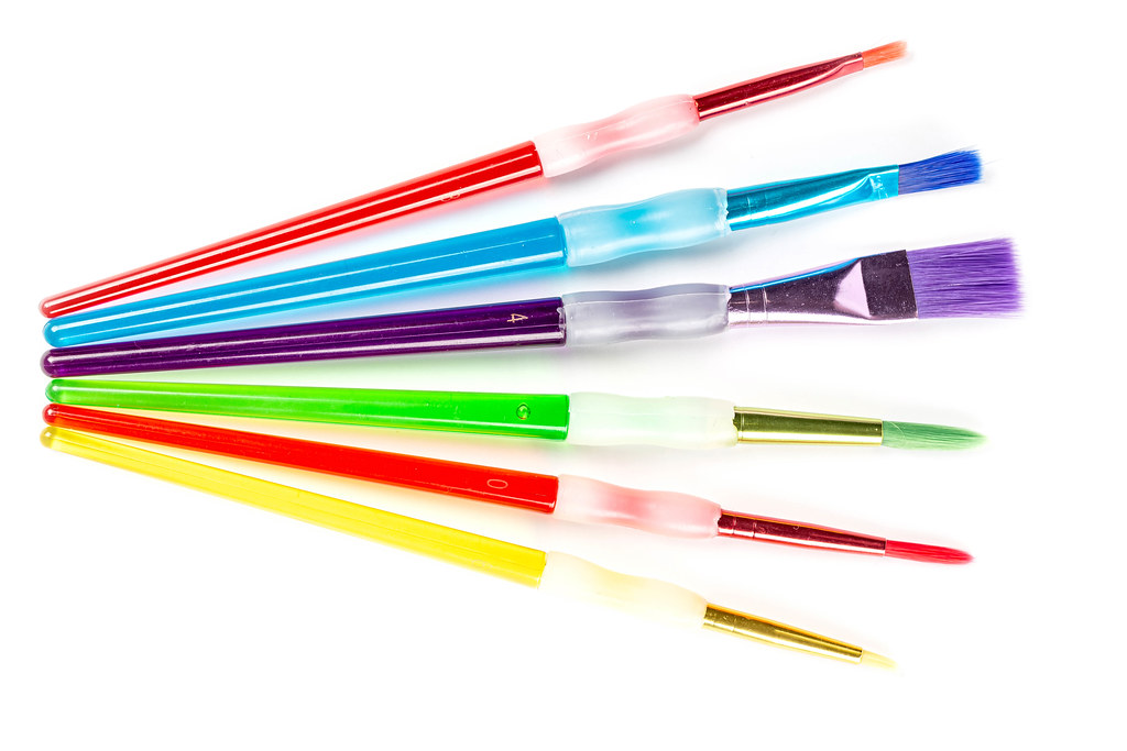 Set of multi-colored paint brushes, top view