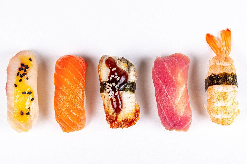 Set of nigiri with seafood on a white background, top view