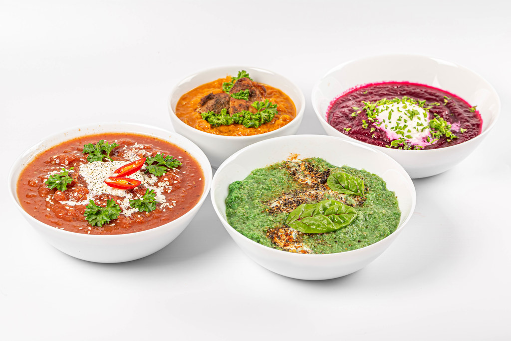 Set of various soups in white bowls