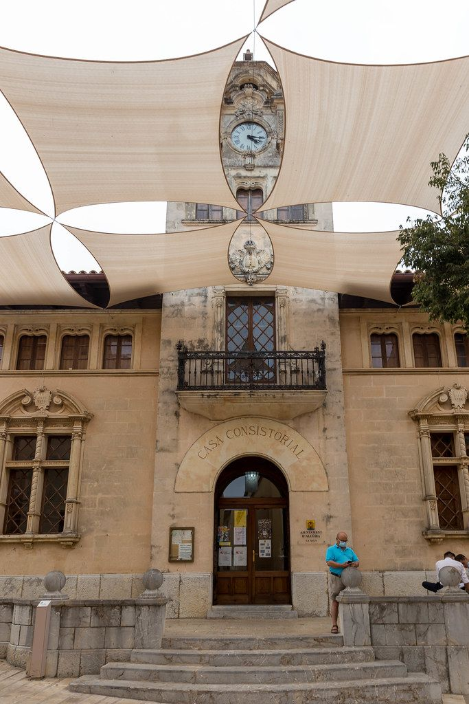 Shade sails in front of the Casa consistorial (town hall) in the old town of Alcudía, north of Mallorca