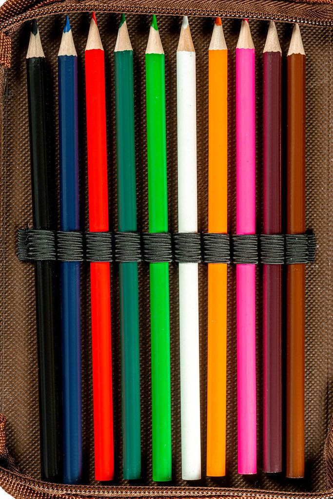Sharpened colored pencils in a pencil case, top view