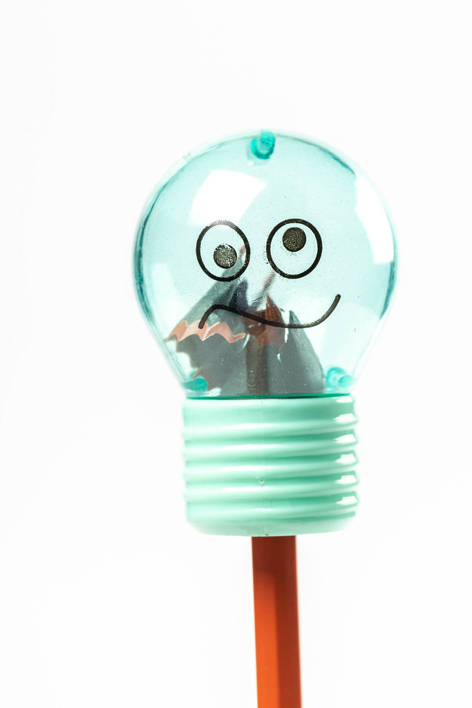 Sharpener in the shape of a light bulb and pencil, close-up
