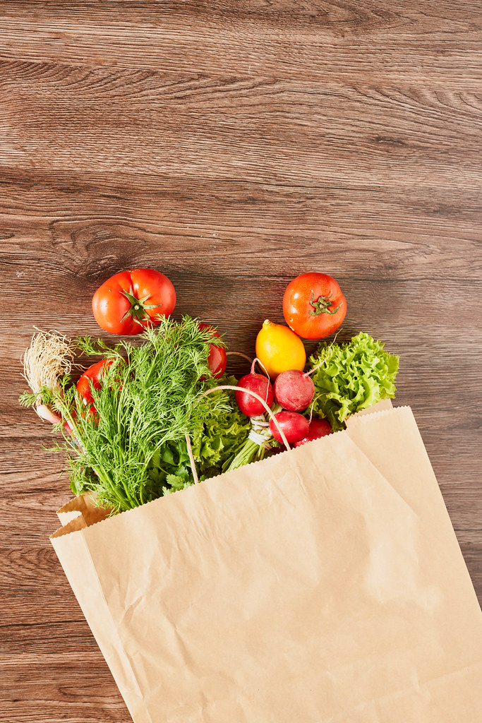 Shopping bag full of fresh vegetables and fruits