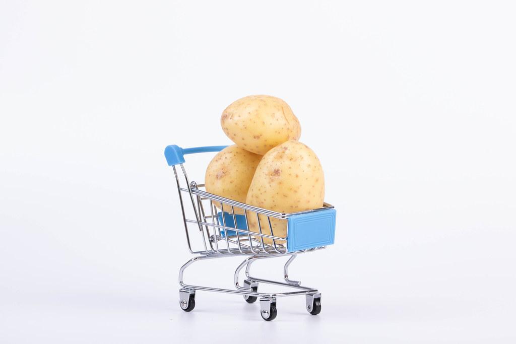 Shopping cart full of potatoes